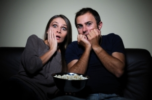 scary people watching movie on tv